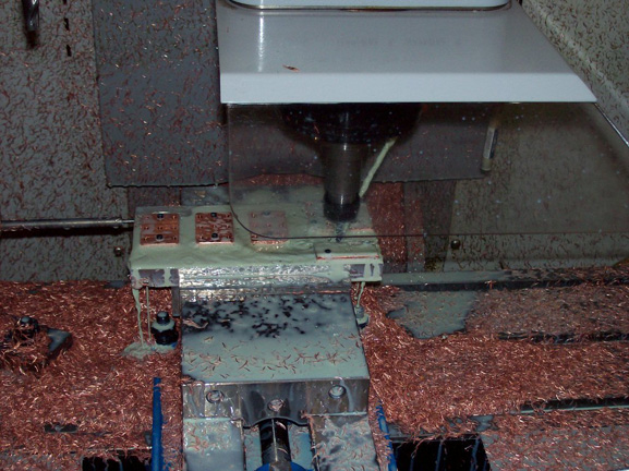 CNC machine churns away at the copper