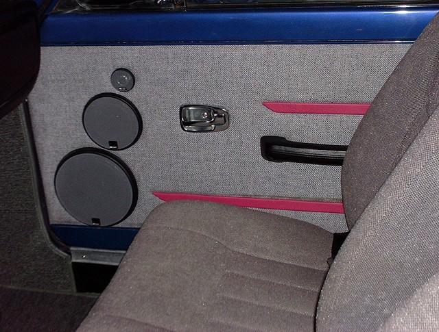 Custom door panel with 3 way front sound stage speakers.