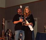 Tim Accepts Trophy